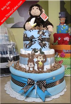 Diaper Cake Idea... Blue and Brown but instead of monkeys, need to find some farm items to incorporate to match bedding. Check registry to find toys, blankets to add!