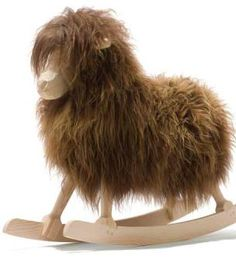 Our classic rocking sheep is wearing a new sheepskin coat of the softest tawny, camel-coloured hues. The quality of the carving and the luxurious feel of the carefully sourced pelts ensures that every rocking sheep that is produced from this humble Danish workshop is as lovely as the first.   Dimensions: H60 x L83 x W25cm