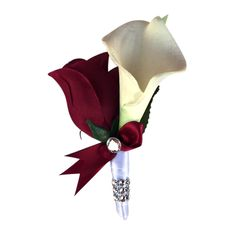 Simply Beautiful. Perfect for all events. Pin included. Calla lily Rose Boutonniere-BurgundyåÊSilk rosebud, real touch feel calla lily-Pin included. Real touch calla lily:real touch calla lilies are w