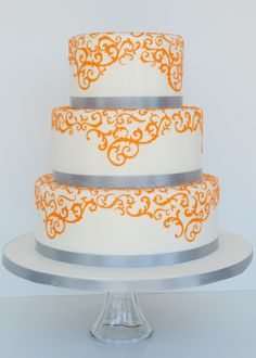 Orange and Grey Wedding Cake - Wedding cake for a orange and grey themed wedding.  The scrollwork is done with a cake cricut.  TFL!