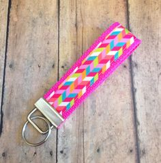 Wrist Loop key fob in a fun Hot pink multi herringbone pattern. 1.25 wide and about 6.5 total length.  These make a great stocking stuffers. Slips