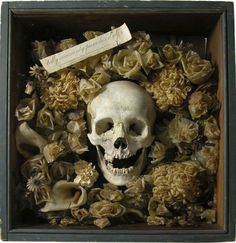 1850s memorial cabinet with real human skull.