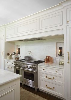 """Cantley & Company Birmingham, AL """"We chose the Wolf Range with a grill and a griddle and opted for the Stainless knob instead of their signature red knobs to keep everything very subdued and soft,"""" says Cyndy. Black Kitchen Cabinets, Kitchen Hoods, Gold Kitchen, Kitchen Cabinet Hardware, Black Kitchens, Kitchen Backsplash, Diy Kitchen, Home Kitchens, Kitchen Design"""