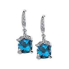 Genuine IceCarats Designer Jewelry Gift 14K White Gold Genuine Swiss Blue Topaz And Diamond Earring. Pair .06 Cttw/07.00X07.00 Genuine Swiss...