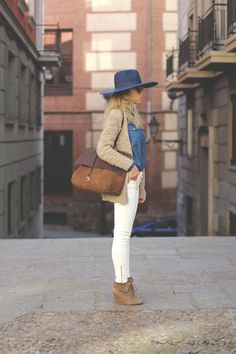 Street Style - White Skinnies, Chambray Top, Tan booties & Sweater with an oversized hat