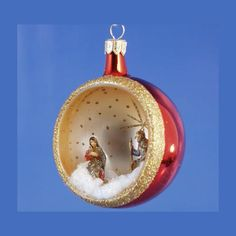 Holy family inside red glass ornament from http://www.thecottageshop.com/De-Carlini-Nativity-red-ornament-P18705.aspx