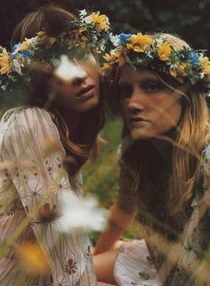 italian vogue, two girl in flower feild with yellow, white, and blue flower wreaths in hair