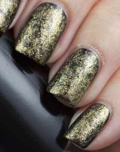 Cling film / Saran wrap manicure using black as the base, and gold over top.