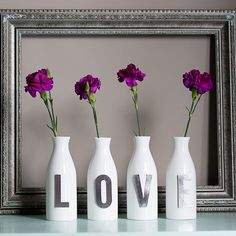 Super cute LOVE vases! would be very cute with red roses and red letters or pink carnations and pink letters
