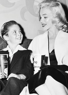 "pickledesign: "" normajeanebaker: "" Original caption: Ten-year-old actor Tommy Rettig has a date to take a girl to the movies and what do you know? It turns out to be fim star Marilyn Monroe. Photgraphers asked Miss Monroe to shed her coat for poses..."