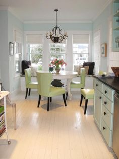HGTV fan susanbf transformed this kitchen with icy blue and white paint and well-chosen accent colors. We love the celery-green chairs and budget black drawer pulls.