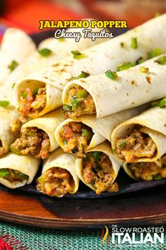 Jalapeno Popper Taquitos are the consummate Game Day food.  An easy recipe that will knock your socks off, with instructions to make-ahead too. Loaded with your favorite popper flavors: jalapenos, bacon and ooey gooey cheese.  #gameday #recipe #beef