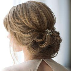 Gorgeous @monicamooresmith #hairandmakeupbysteph #updo #bridalhair #weddinghair