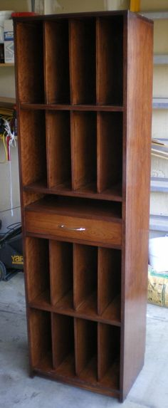 This would be cool for record storage... maybe with a pull-out shelf for a player instead of that drawer...