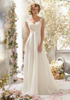 Romantic A-line bridal gown with lightly beaded lace v-neck bodice and a soft flowing chiffon skirt