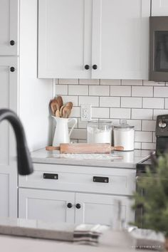 Follow along the makeover of this beautiful farmhouse kitchen! In this post, Liz shares the cabinets and hardware she used.