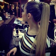 There is something so delightfully girlie about a high pony with long, straight hair