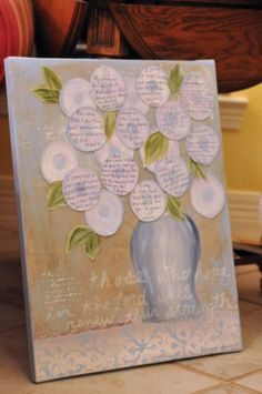 Personalized painting to act as a guest book: created a vase on a canvas and, separately, little flowers on which friends wrote well wishes for the couple. The flowers were then attached to the original painting