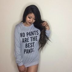 """NWOT NO PANTS ARE THE BEST PANTS LONG SLEEVE TOP NWOT, open to trades and offers 10/10 condition. My favorite shirt but its too """"controversial"""" to wear in public. Its super long like a sleep shirt, meant to cover up your butt, """"no pants"""". Could fit a large. NOT BRANDY Brandy Melville Sweaters Crew & Scoop Necks"""