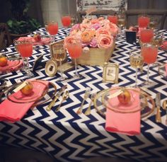 Navy Chevron, Coral, and gold tablescape from the Sumner County Bridal Show. We were featured on News Channel 5's Talk of the Town!