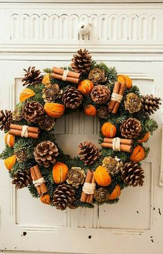 21 DIY Christmas Wreaths to Make Now! - Sharp Aspirant Thinking of making your own Christmas wreaths? You're going to love these fun and creative Christmas wreaths ideas! They're simple and easy to make and don't cost too much. Christmas Tree Decorating Tips, Rustic Christmas Ornaments, Christmas Door Wreaths, Christmas Door Decorations, Christmas Centerpieces, Christmas Crafts, Christmas Ideas, Christmas Holidays, Orange Christmas Tree