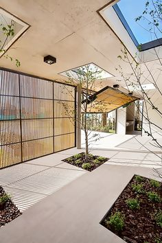 Outdoor space with cool garage doors and a skylight