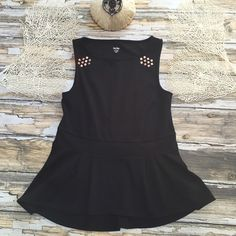 """Copper Studded Black Peplum Top Black Peplum Style Top.  Copper Hardware Adorns Shoulders.  No Material / Care Tag.  Knit with Stretch.  Bust 30""""-32"""" ( Flat / Stretched).  23"""" Front Length.  25"""" Back Length.  Excellent Condition. Mossimo Supply Co Tops Tank Tops"""