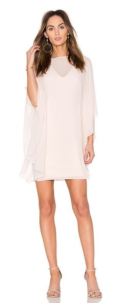 Fitted Ponte Dress With Sheer Overlay by Halston Heritage. Self:100% polyContrast: 60% rayon 34% nylon 6% elastaneLining: 92% poly 8% elastane. Fully lined. Dry clean only. She...