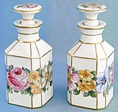 Vintage Pair of Porcelain Hand Painted Porcelain Perfume Bottles  Decorated with many types of Wildflowers some of which are: Pink Prairie WildRose, White Ox Eye Daisy, Yellow Orange Hairy Puccoon, Red Orange Poppy, Blue Explorers Gentain and more. Hand painted Flower Acented with Raised Paint. Bottle Stoppers Accented with a Heavy Gold Bands.