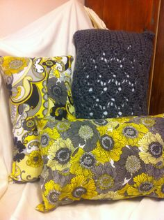 Homemade Crocheted Pillow with sewn accent pillows.