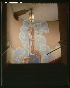INTERIOR DETAIL OF A MURAL ON THE WALL AT THE TURN IN THE STAIRWAY, AND LIGHTING FIXTURE. - Anaconda Historic District, Washoe Theater, 305 Main Street, Anaconda, Deer Lodge County, MT