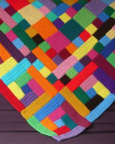 Designed by Leslie Stahlhut: This is a large, mutli-color afghan made from many separate pieces. There are designs within the design.