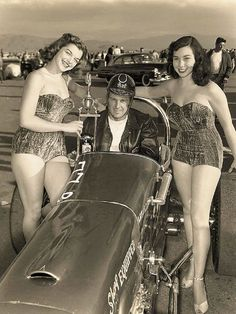 Hot rod driver Art Chrisman and models, 1955.. notice how the models actually have muscles and fat?? Instead of twigs? I like these models much better! So much prettier!