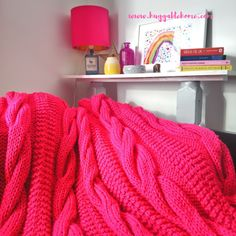 Colorful cable knit blanket is a great spring/summer update to inject a pop of cheer Colorful Frames, Colorful Decor, Large Storage Units, Cable Knit Blankets, Colourful Living Room, Pink Blanket, Hygge Home, Bubblegum Pink, Wall Spaces