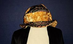 Hey, I found this really awesome Etsy listing at https://www.etsy.com/listing/520429906/vintage-1960s-funky-tam-hat-amber-black