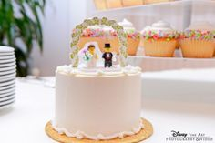 One-tier wedding cake with LEGO bride + groom topper