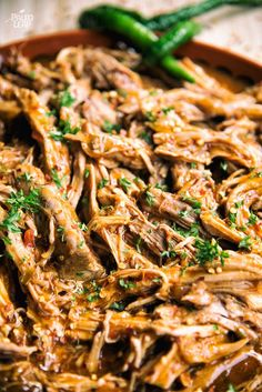 Mexican-Style Pulled Pork - A slow cooker pulled pork recipe made with a Mexican-Style Rub, salsa and enchilada sauce.