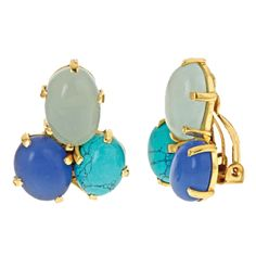 """This earring, inspired as much by Gaudi as it is by the glittering Caribbean, features three cabochon gemstones in a 24K gold plate setting. Structural yet organic, it's the piece that elevates any outfit to a complete """"look.""""     DETAILS: 24K gold plate, 3/4 inch drop  Due to variations in stones coloring may vary"""
