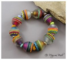 carnavale by magma beads; It would be fascinating to make beads in polymer with a faux lampwork effect