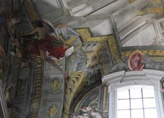 Andrea Pozzo's virtual space.  Fresco (detail).  Pozzo created the illusion that Heaven is opening up above the viewer's head by continuing the church's architecture!  St. Ignatius.  Rome.