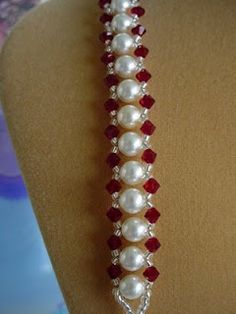 Bracelet: Put a pearl in the middle of your thread. Thread 2 needles at either end of your line. String on beads and a pearl. Cross threads at the pearl. Repeat until desired length. Make a loop at the end with beads for clasp loop. Use more beads and a button for clasp.