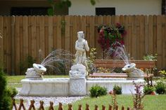 A classical tribute to the Greek god of the sea, Poseidon features prominently in this garden walkway. Large sculpted fountains such as these provide everything you need to install a larger, above ground swimming pool and fountain display.