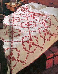 Red and white Burgoyne Surrounded quilt