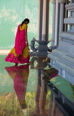 loved this photo..and this floor,almost mirror like,and the posture of the lady..very indian.