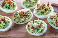 Deviled Eggs with a kick, avacado and jalapeno style. Hold the bacon please.