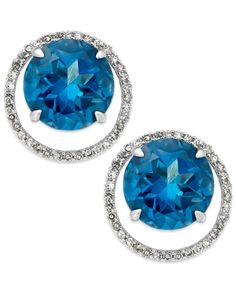 Cue the blues. These stunning earrings flaunt round-cut London blue topaz (6-5/8 ct. t.w.) surrounded by single-cut diamonds (1/4 ct. t.w.) for a look that hits all the right notes. Crafted in 14k whi