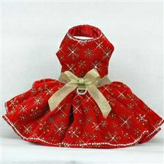 Rich red velvet dog dress with gold snowflake print.  Single row of Swarovski crystals at neck and hemline.  Each snowflake center features a Swarovski crystal too. http://www.littledogfashion.com/Red-Velvet-Dog-Dresses-for-Formal-Christmas-Holida-p/drs-red-velvet-snow.htm