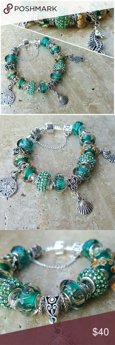 Down under, beach ocean theme charm bracelet One of a kind! At the heart of the sea and all that is under. Gorgeous hand selected, premium quality; deep sea colored glass and crystals placed together w shell, seahorse and sand dollar charms on a silver plated chain. These beads will pair seemlessly w all other name brands. Can be moved to a bangle style or lobster clasp depending on size. Hand designed and created with care, in the USA!  Custom orders welcome, discounts given on bundles…
