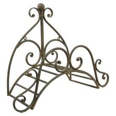Iron garden hose holder with scrollwork detail. Product: Hose holderConstruction Material: IronColor: RustDimensions: 9 H x 20 W Iron Furniture, Steel Furniture, Outdoor Metal Plant Stands, Wrought Iron Wall Art, Garden Hose Holder, Iron Steel, Iron Work, Plant Holders, Joss And Main