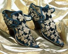 Shoes: probably worn by Lady Mary Stanhope (1660) Women's Velvet Shoes  Made of blue velvet and embroidered with silver gilt thread, these shoes must have been worn for a special occasion. The latchets would have tied across the tongue with a decorative ribbon possibly gold in colour.    Story:  Could these shoes have been worn during the celebrations, which took place after the Restoration of Charles II in 1660?    Lady Mary was the wife of Sir John Stanhope of Elvaston Castle in Derby...